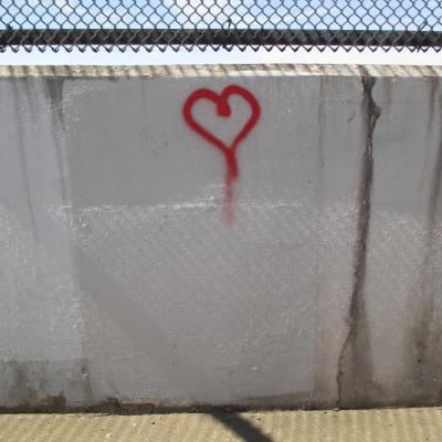 spray paint heart on bridge railing, Pittsburgh, PA