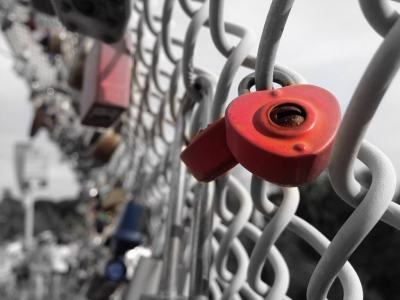 heart-shaped lock on chain link fence