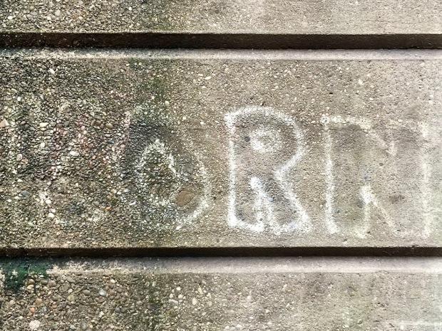 faded graffiti for metal band Korn on cement wall, Sharpsburg, PA