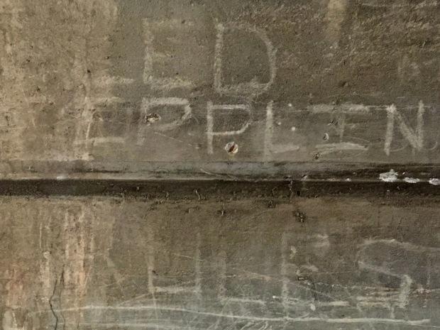 "faded graffiti reading ""Led Zepplin rules"" on cement wall, Sharpsburg, PA"