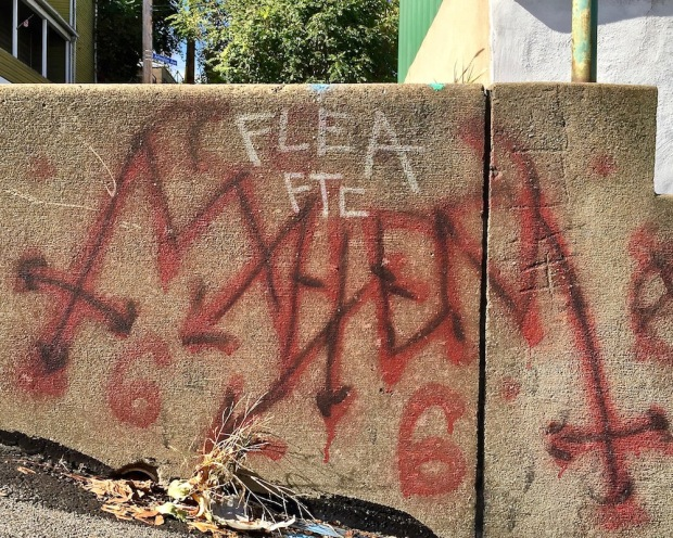 graffiti tribute to Norwegian metal band Mayhem on cement wall, Pittsburgh, PA