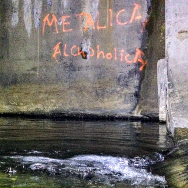 graffiti for metal band Metallica spray painted on cement wall, Munhall, PA