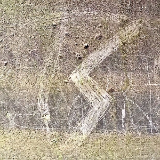 logo for hard rock band Twisted Sister scratched into cement, Sharpsburg, PA