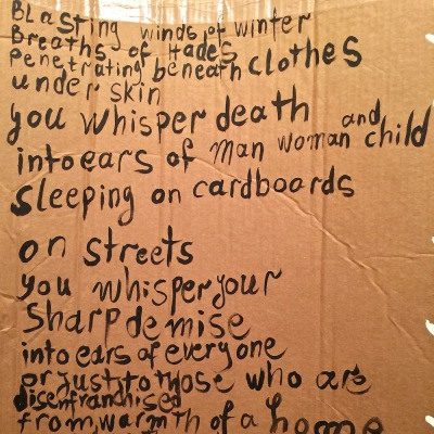 detail of poem about homelessness painted on cardboard