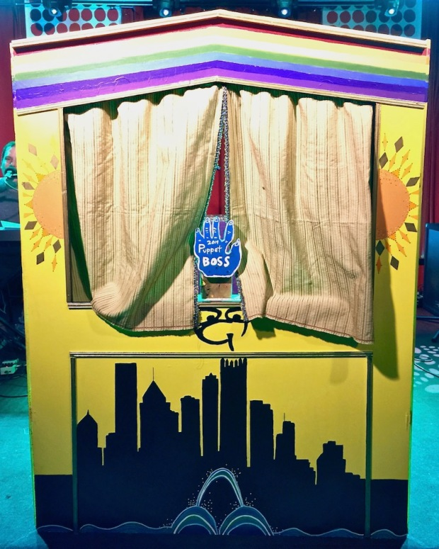 handmade puppet stage decorated with Pittsburgh skyline