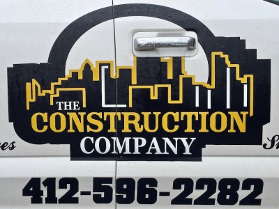 logo for The Construction Company featuring artistic rendering of Pittsburgh skyline in black and gold