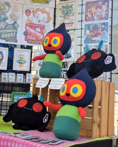 stuffed toys of Flatwoods Monster and Moonlight Mothman for sale at the 2019 Mothman Festival, Point Pleasant, WV