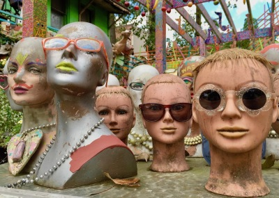 collection of mannequin heads wearing sunglasses at Randyland