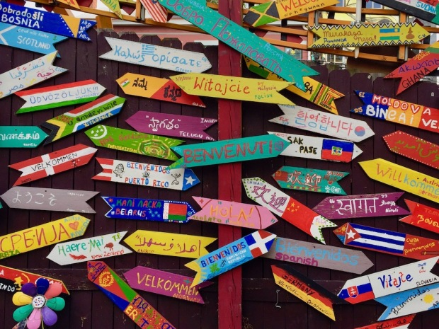 handmade welcome signs in many different languages at Randyland, Pittsburgh, PA