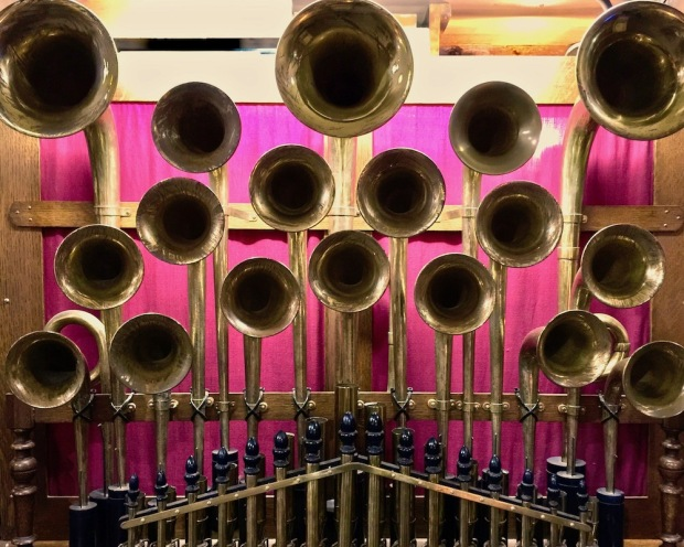 brass horns attached to elaborate band organ at DeBence Antique Music World
