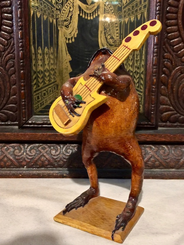 novelty decoration of real frog, stuffed with sawdust, holding a guitar at DeBence Antique Music World