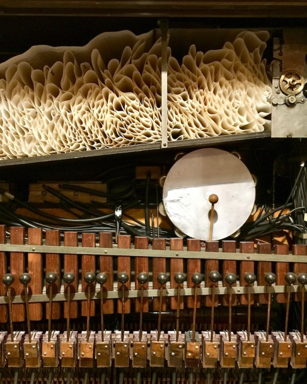 interior of nickelodeon music machine including player scroll, xylophone, and percussion at DeBence Antique Music World