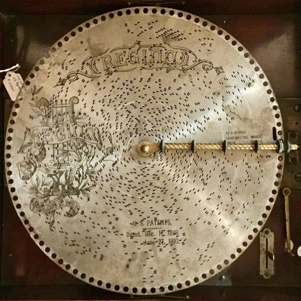 metal musical disk on antique player at DeBence Antique Music World