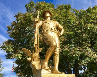 World War I memorial featuring doughboy statue painted gold in Townsend Park, New Brighton, PA