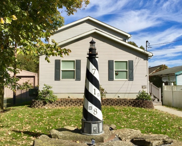 large decorative lawn lighthouse in front yard of home in Bridgewater, PA