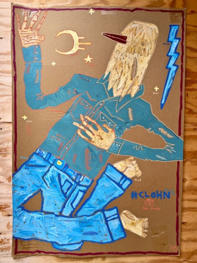 street art painting of bird wearing jeans and western-style shirt on cardboard