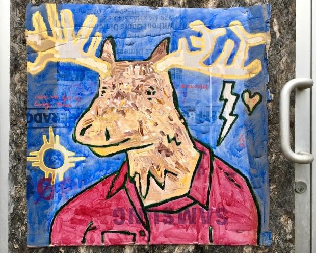 street art painting of deer with large antlers on cardboard