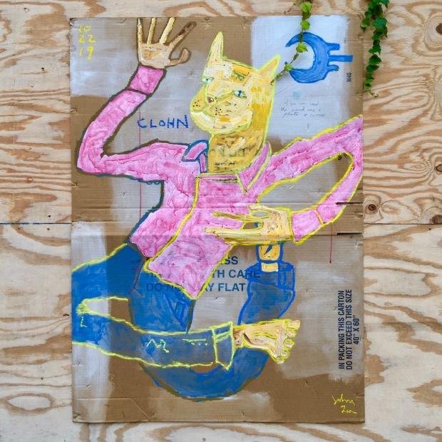 street art painting of cat in pajamas on cardboard