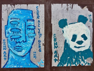 street art paintings of man with five eyes and panda bear