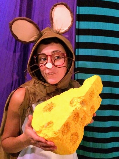actress dressed as mouse with large piece of cheese