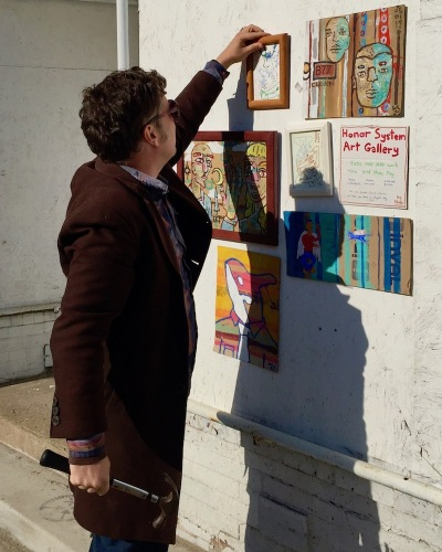 "artist John Lee (aka ""Clohn Art"") installing Honor System Art Gallery, Pittsburgh"