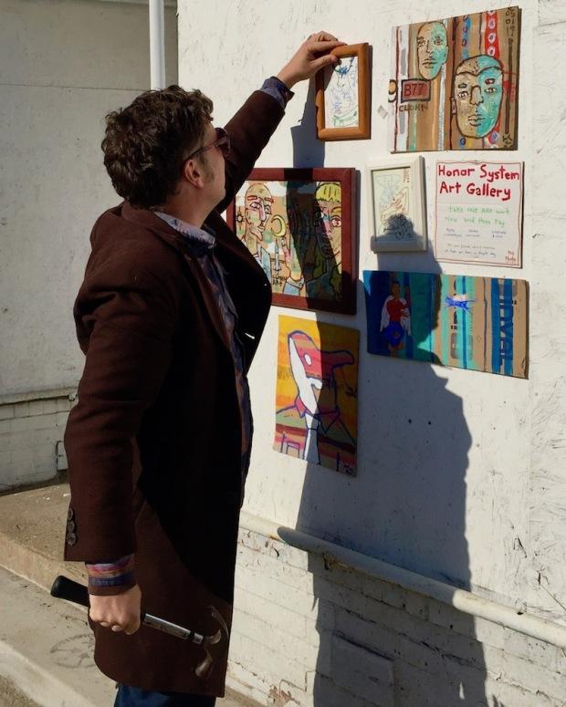 "artist John Lee (aka ""Clohn Art"") installing Honor System Art Gallery, Pittsburgh"