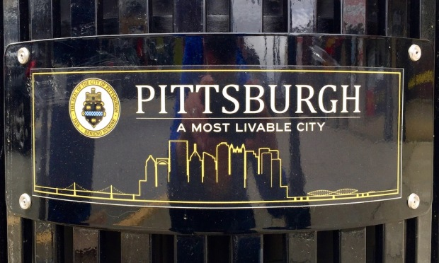 waste bin plaque including the Pittsburgh skyline