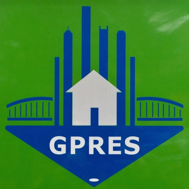 blue and green logo for Greater Pittsburgh Real Estate Services featuring stylized version of downtown Pittsburgh skyline