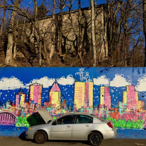 mural by Baron Batch depicting cartoonish, colorful version of downtown Pittsburgh skyline