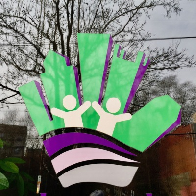 logo for Pittsburgh Cares with caricature of the Pittsburgh skyline as fingers in a hand