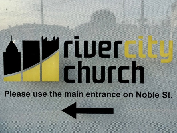 black and gold logo for River City Church with three iconic downtown Pittsburgh buildings in silhouette