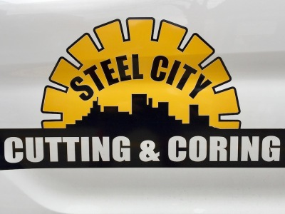 black and gold logo for Steel City Cutting & Coring including city skyline