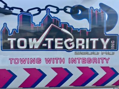 logo for Tow-Tegrity towing service including the Pittsburgh skyline and giant hook