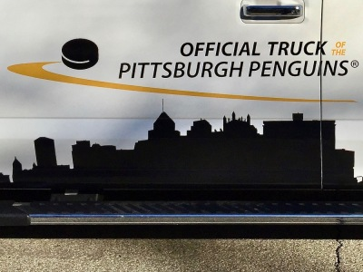 "Pittsburgh skyline on side of Ford truck with the message ""the Official Truck of the Pittsburgh Penguins"""