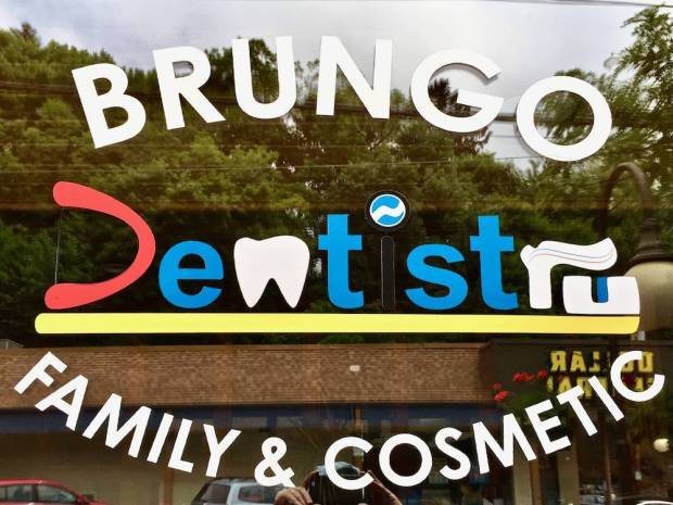 logo for Brungo Dentistry including colorful letters made to look like teeth, toothpaste, and a toothbrush