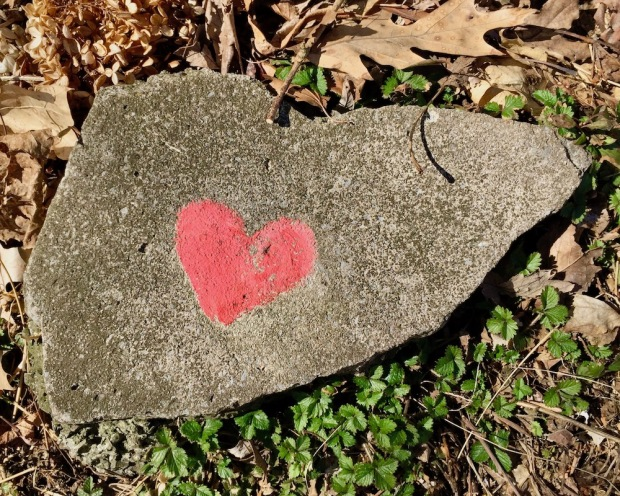 small painted heart on chunk of concrete