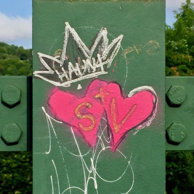 "graffiti of two hearts with ""S+V"" written in them"