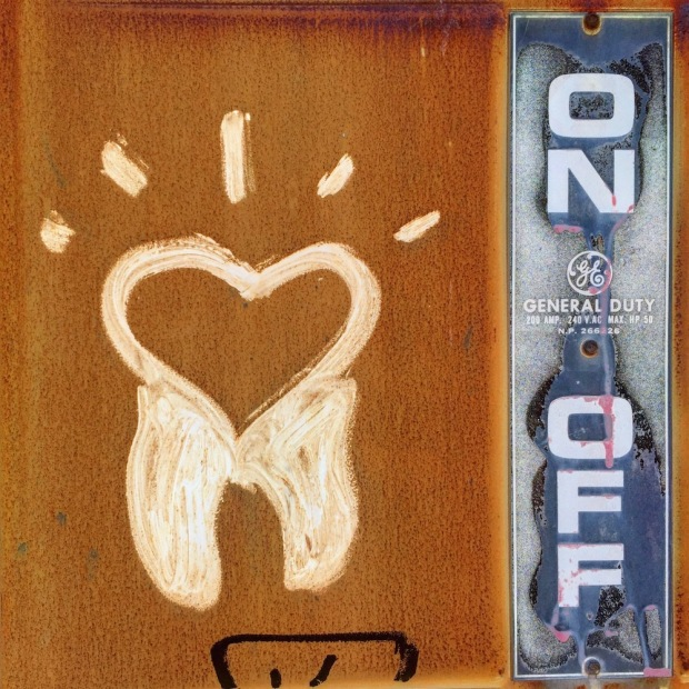 graffiti image of combined tooth and heart