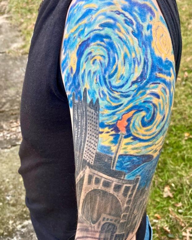 Monessen mayor Matt Shorraw's tattooed arm including image combining downtown Pittsburgh with flaming smokestack of Monessen