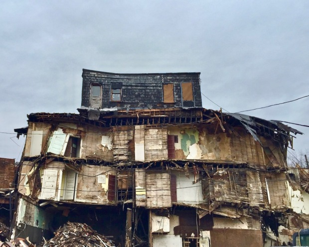four-story building mid-way through being torn down