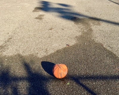 flat basketball on empty macadam