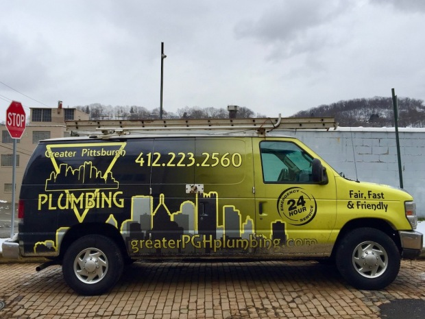 Greater Pittsburgh Plumbing van decorated with two different versions of the Pittsburgh skyline