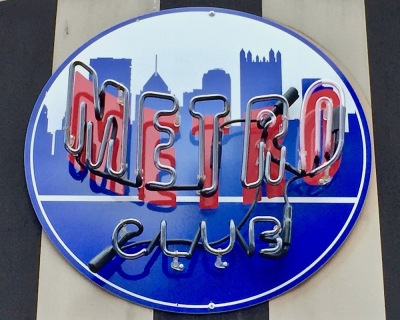 logo for Metro Club featuring silhouetted buildings from the Pittsburgh skyline