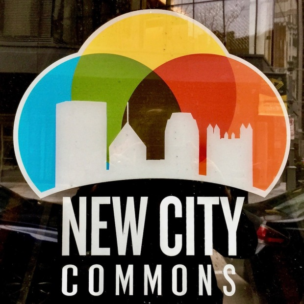 logo for New City Commons featuring silhouetted buildings from the Pittsburgh skyline
