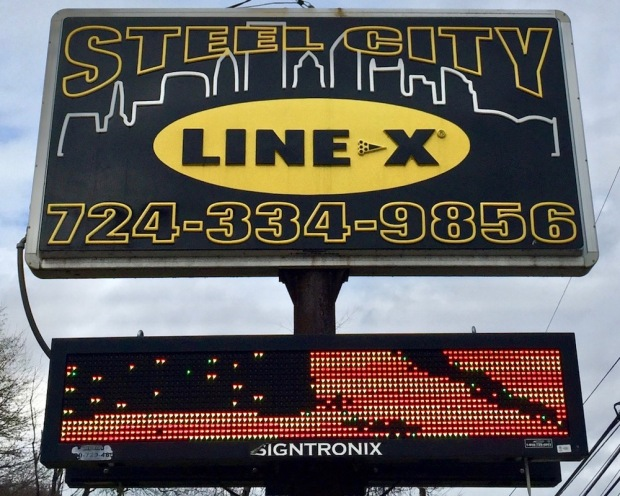 sign for Steel City Line-X including the Pittsburgh skyline
