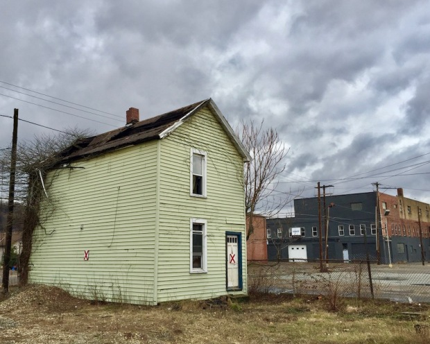 """small wood frame house marked with red """"X"""" for demolition, New Kensington, PA"""