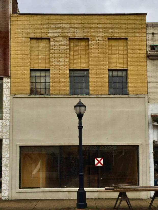 """older brick commercial building with red """"X"""" for demolition, New Kensington, PA"""