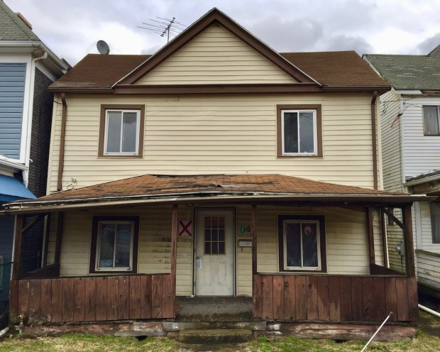 """wood frame house marked with red """"X"""" for demolition, New Kensington, PA"""