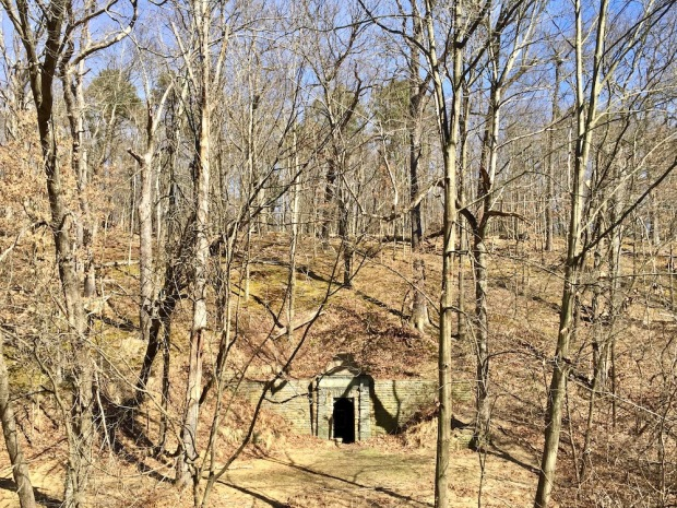 spring house grotto built into wooded hillside