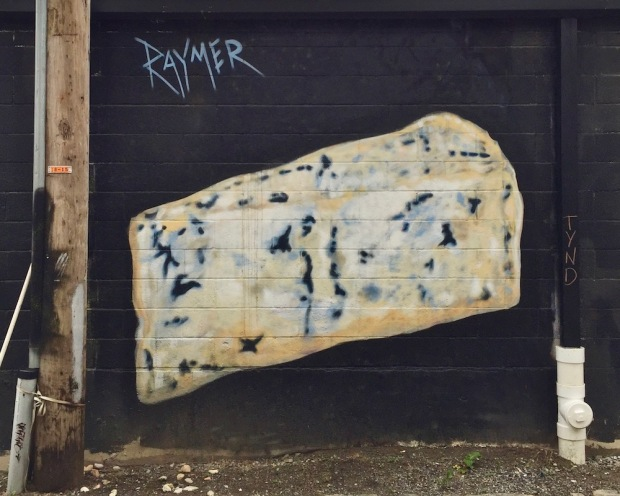 mural of block of blue cheese painted by artist Jeremy Raymer